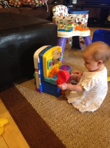 Chyler playing with her new kitchen.....she loves this thing!